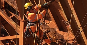 Construction employee working at tall bridge site in western australia